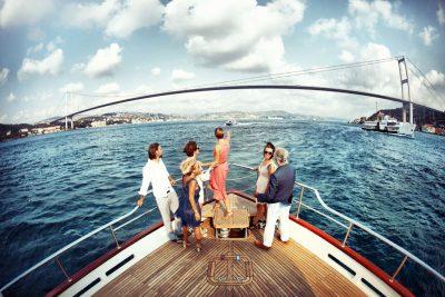 5 friends having a bosphorus cruise tour at Bosphorus sea of Istanbul