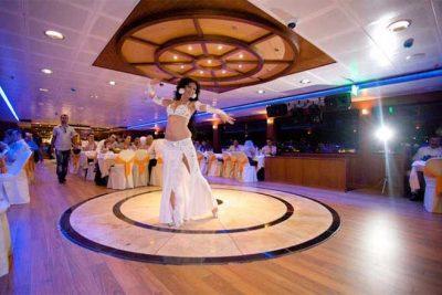 A bellydancer dances at the istanbul bosphorus dinner cruise show